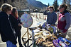 Whiskey Warmup visitors take a moment to check out the Rocky Mountain Nature Association's table on Saturday. The RMNA educated and entertained visitors about the animals and the ecosystem of the park and the Estes Valley.
