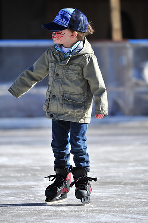 A young skater glides across the ice at the Whiskey Warmup event downtown on Saturday. The event began on Friday and lasted through the weekend.