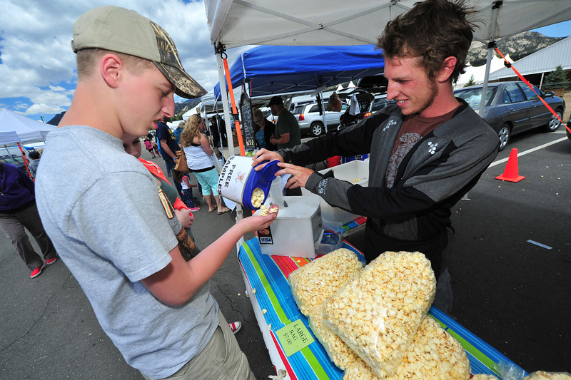 Colton Clark, 15, of Lincoln, Nebr., gets a handful of kettle corn on Thursday.