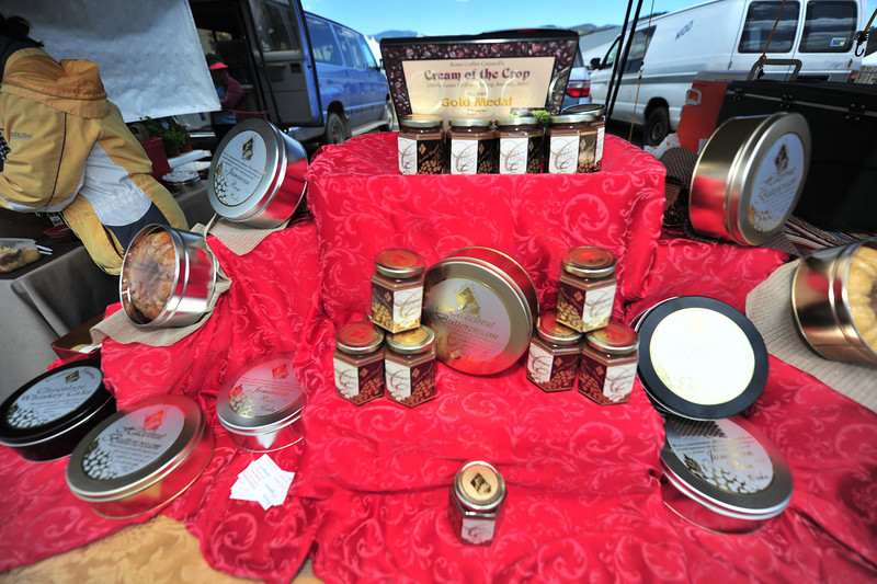 Various rum and whiskey cakes cover a table. Every year new items appear at the farmers' market.