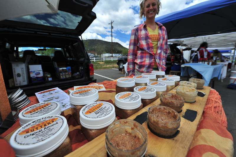 Alex Weiser shows off both new concoctions and old favorites of her home made nut butters on Thursday. Weiser, like many of the vendors, visits several of the farmers' markets.