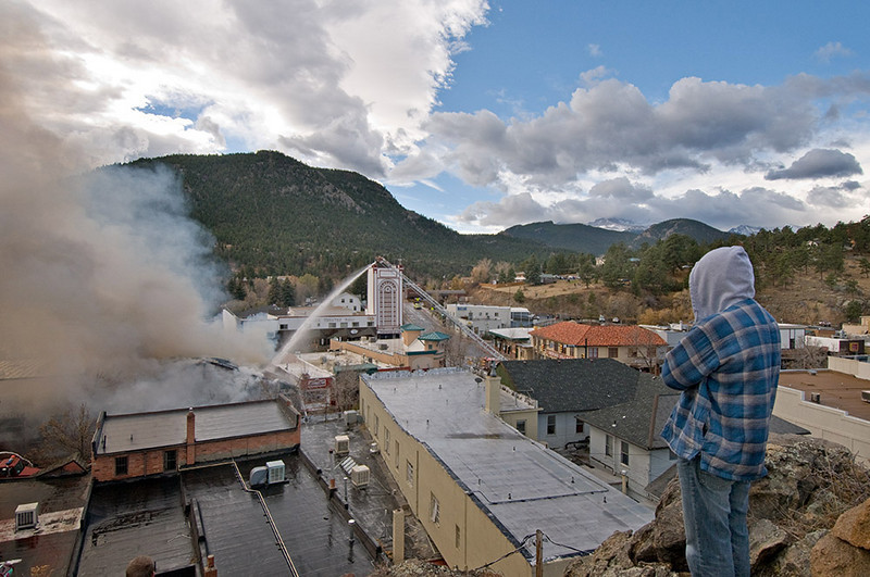 "MALLFIRE844.JPG A view of the Theatre Mall fire from ""The Knoll"" as firefighters attack the fire and residents gather to view the situation in Estes Park on Monday morning.<br /> Photo by Norman Smith"