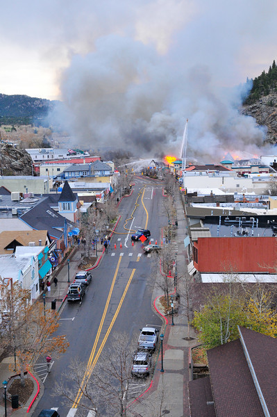 21EP News Historic View Fire 5.jpg Photo by Walt Hester<br /> Smoke blights the scene looking east down Elkhorn Avenue as fire fighters attempt to contain the Park Theatre Mall on Monday morning..