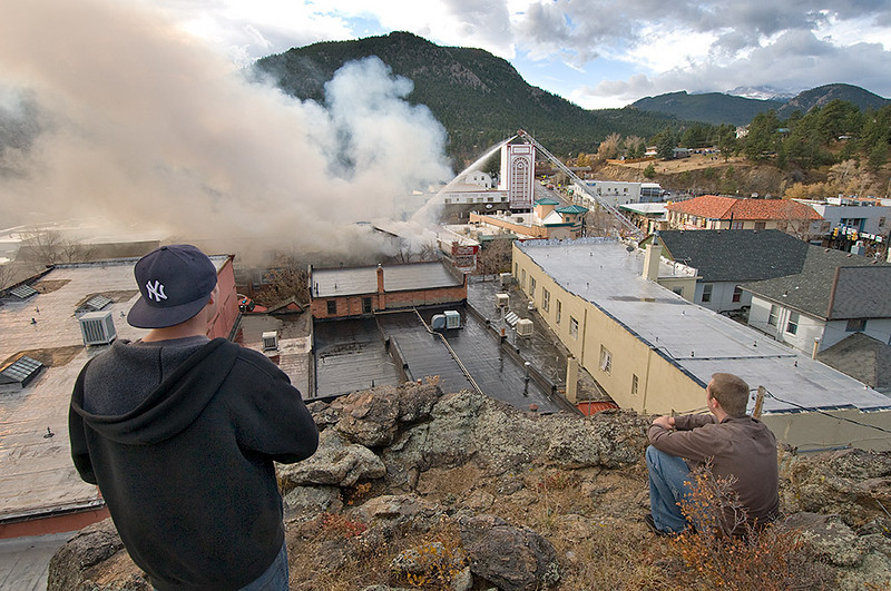 """MALLFIRE847.JPG A view of the Theatre Mall fire from """"The Knoll"""" as firefighters attack the fire and residents gather to view the situation in Estes Park on Monday morning.<br /> Photo by Norman Smith"""