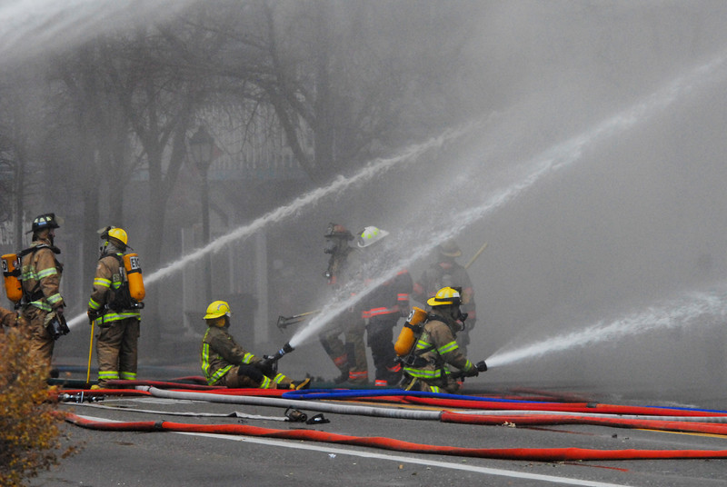 21EP View Firefighters.jpg Photo by Walt Hester<br /> Firefighters and equipment fill Elkhorn Avenue in front of the Park Theater Mall on Monday. Officials closed Elkhorn Avenue early on Monday to accommodate the effort, and widened the restricted area as smoke filled downtown.