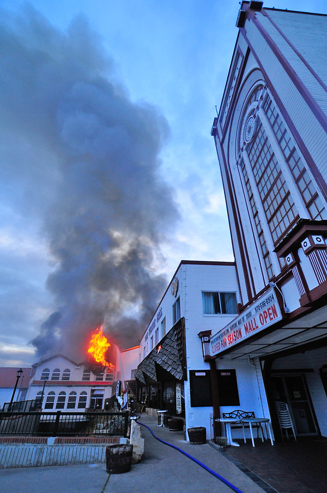 21EP View Scary Moments.jpg Photo by Walt Hester<br /> Flames and smoke engulf the Park Theater Mall just steps away from the oldest operating theater in the US. The west wing of the mall may have been spared due to the efforts of the many firefighters and agencies that fought the fire.