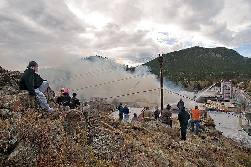 "MALLFIRE843.JPG A view of the Theatre Mall fire from ""The Knoll"" as firefighters attack the fire and residents gather to view the situation in Estes Park on Monday morning.<br /> Photo by Norman Smith"