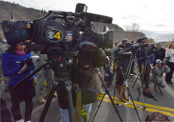 The media lined up along Hwy. 36 Monday morning, Nov. 4., near Lyons, for the reopening ceremonies for the highway beween Estes Park and Lyons that has been shut since mid-September after it was damaged by flood waters.