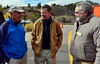 Estes Park Mayor Bill Pinkham, left and town administrator Frank Lancaster, right, speak with Colorado Governor John Hickenlooper, center, at Monday's opening ceremony for Hwy. 36.