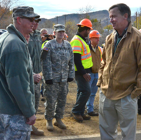 Colorado Governor John Hickenlooper, right, visited with members of the Army National Guard prior to the Nov. 4 reopening ceremonies for Hwy. 36 between Estes Park and Lyons.