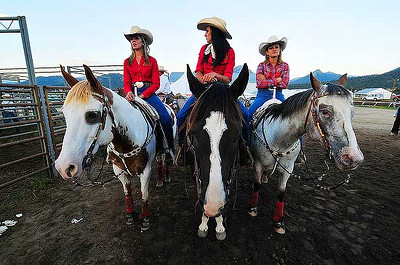 Bec Circosta, Brandi Phillips and Aly Love, all of the Riata Ranch Cowboy Girls  await their turns to make flag runs during Thursday's rodeo. The ranch, located in Exciter, Calif. teaches girls confidence and self-respect through trick roping, trick riding and general horsemanship. Photo by Walt Hester