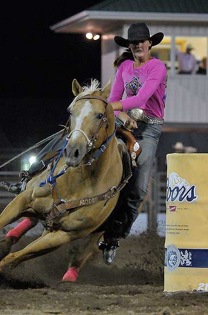 Mandy Hagler of Platteville, Colo. rounds the last barrel as she sets a best time of the night on Wednesday. Photo by Walt Hester
