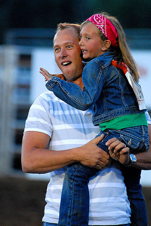 Erle McCrea of Estes Park hugs his daughter, Kristen, after her winning ride during Saturday's Mutten Busting. Photo by Walt Hester