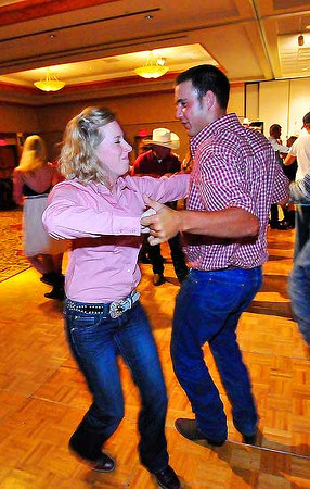 Emily Benjamin of Donnellson, Ipwa spins and sways with Ryan Goforth of Longmont during Saturday night's Queens Dance at the Estes Park Convention Center. Photo by Walt Hester