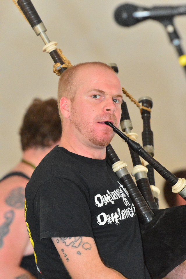 """Albannach musician Donnie MacNeill plays """"Outlaw tunes on outlaw pipes"""" during their first set in the rock tent on Friday."""