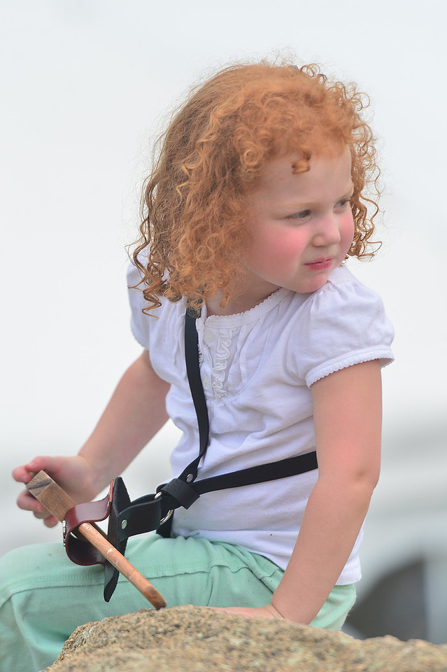 Mamie House, 3, of Wichita, Kans., looks around for her parents at the ScotFest on Friday. The festival attracts an unusual proportion of redheads.