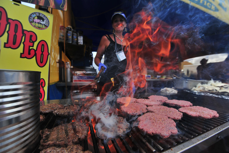 Sandra Baker flips Scottish beef at the ScotFest on Friday. A visitor will not go hungry at the festival.