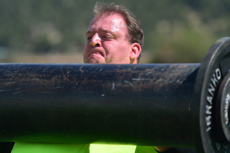 "Bob Benson of Larime, Wyo., lifts a bulky metal ""log"" weighing more than 250 pounds on Friday. The event was the ScotFest's Strongman Competition, in which athletes lift heavy and sometimes bulky and awkward objects."