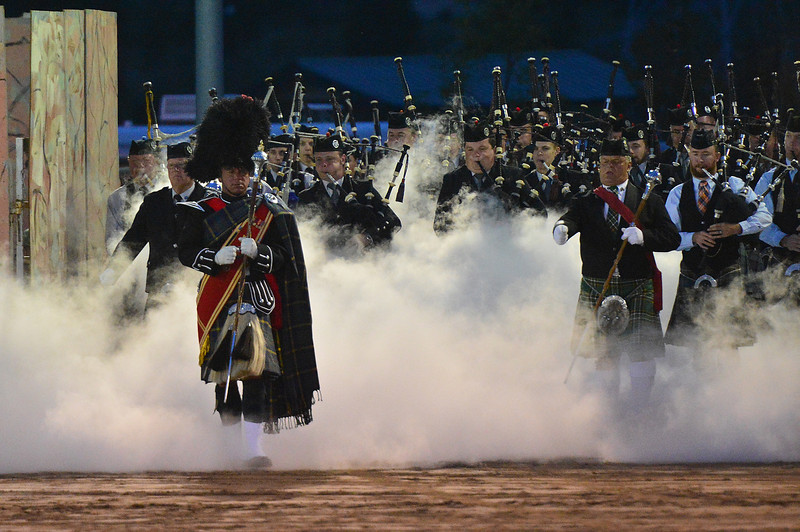 The massed pipe bands enter the arena during Thursday night's opening Estes Tattoo. The tattoo is the gathering of all of the marching bands of the festival.