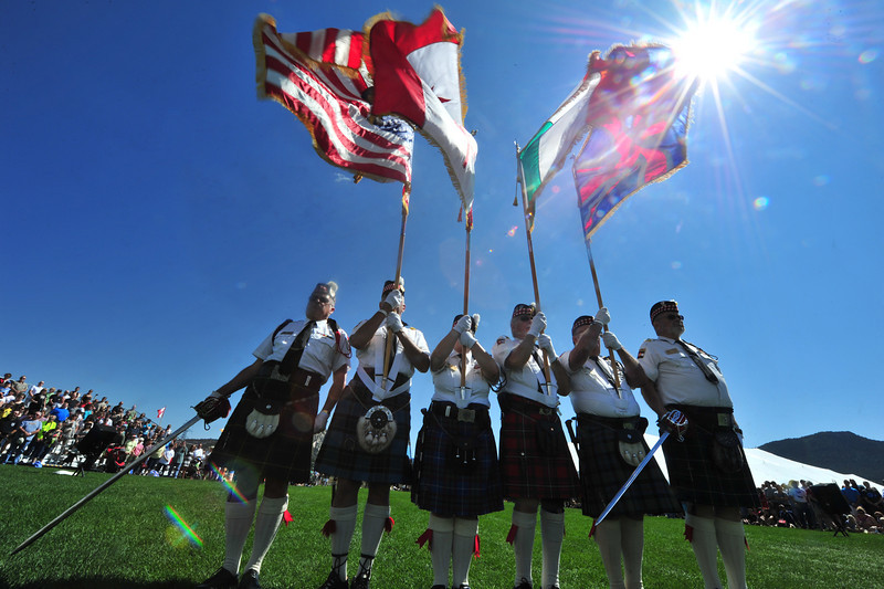 Flags of the festival fly over the parade grounds on Saturday.