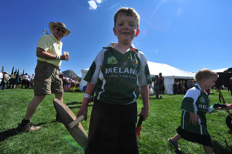 A young ScotFest attendee takes a short break from a sort of combat with siblings at the festival on Saturday.
