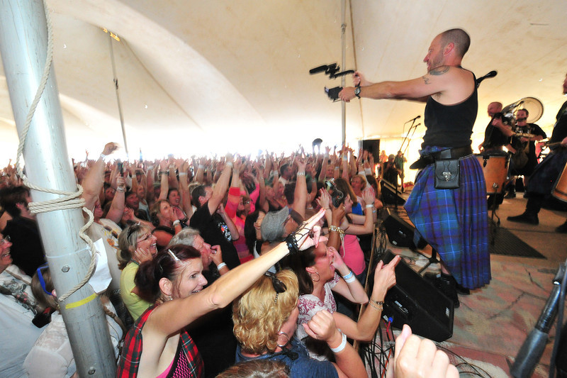 Phillip McFall shoots video of the crowd during a set by the wildly popular band Albannach on Saturday. The band is putting together a DVD that will include images of the Longs Peak Scottish-Irish Highland Festival.