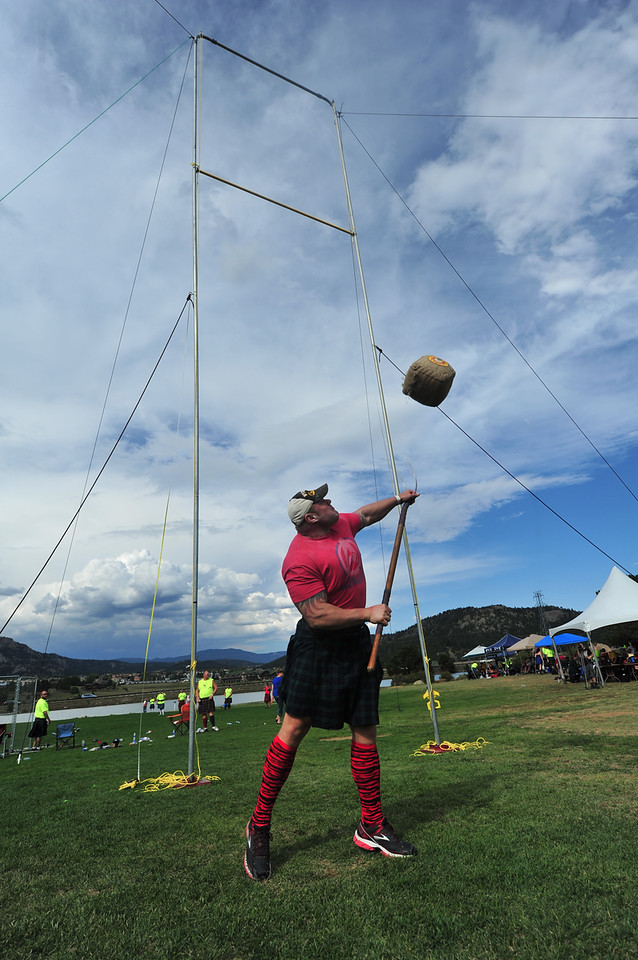 A proffessional Highland athlete tosses a sheaf, or bundle of hay, over a 28-foot-high crossbar on Saturday. While some of the events require brute force, many, like the sheaf toss, require a bit of technique.