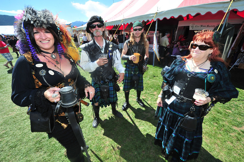 A group of festival visitors enjoy unusual dress on Saturday. Visitors go out of their way to dress for the ScotFest.
