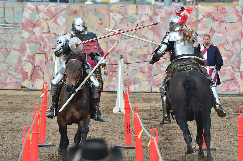 Robbie Hubbard, left, tries to regain balance after taking a hit from the lance of Shane Adams during Sunday's final rouns of the Heavy Armor Jousting World Championship. Adams is credited with founding modern jousting and has won multiple world championships.