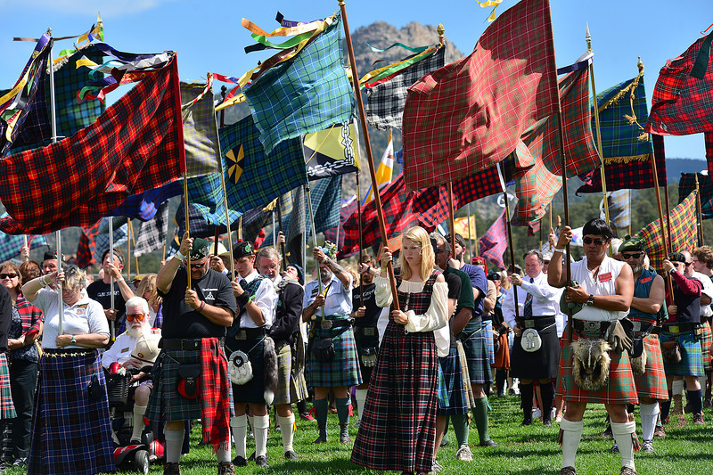 Clan representatives hold their respective tartans on the parade field of the Longs Peak Scottish-Irish Highland Festival on Sunday. The Kirkin of the Tartans is a blessing the dates back to the 18th century when the tartans and Highland dress were outlawed.