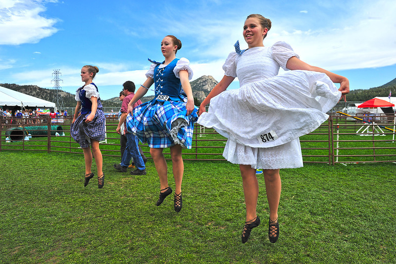 Alli Park, 12, Highlands Ranch, Julianna Hughs, 15, of Lakewood, and Madison Park, 14, Highlands Ranch prepare for competition in the Premier division on Sunday. The Longs Peak Scottish-Irish Highland Festival is more than haggus and kilts, as dancers, pipers and jousters converge on Estes Park to determine the best in their disciplines.