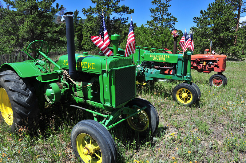 Vintage tractors decorate Hwy 7 in Allenspark on Wednesday. The tiny village about 15 miles south of Estes Park has a feel all its own to offer summer visitors.