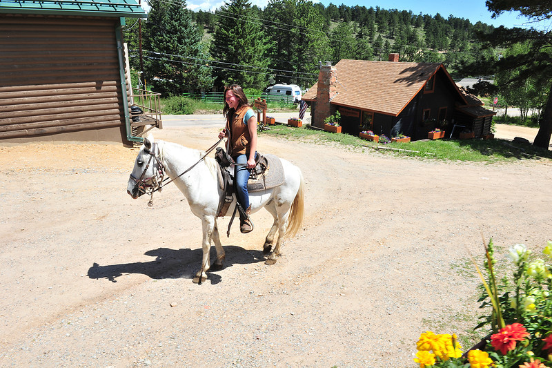 A rider takes a four-hoofed ride through Allenspark on Wednesday. The town is small enough to offer horseback riders a safe day through town.