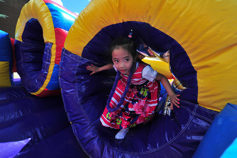 Dawn Nguyen looks around as she emerges from an inflated tube at the Estes Park Aquatic Center on Saturday. The tube was a part of one of the Back to School Bash's three bouncy castles.