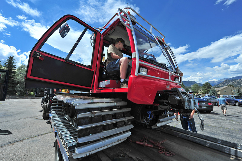 Kids get to explore the cab of a snowcat at the Back to School Bash held at the Estes Park Aquatic Center. The event featured several large pieces of work equipment for children to explore.