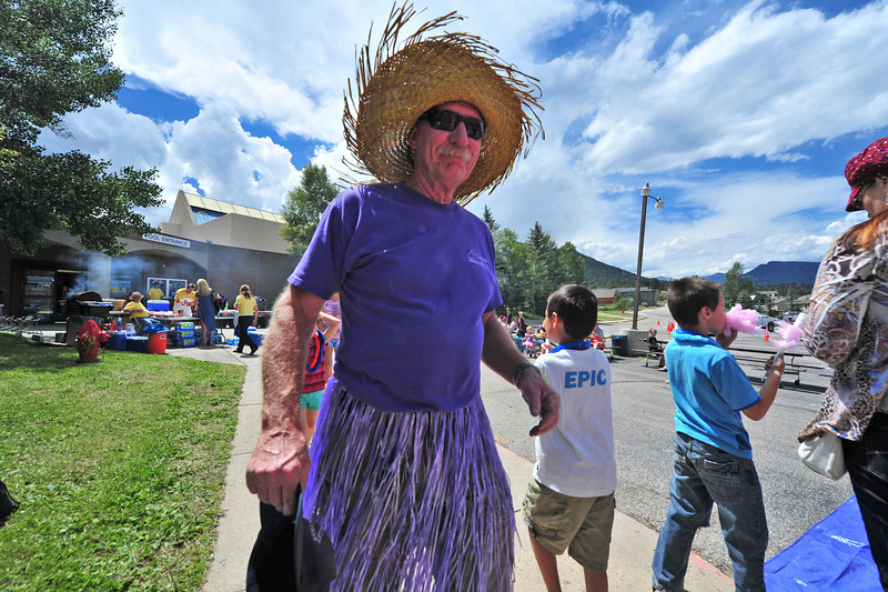 Greg Farmer of the Estes Valley Recreation and Parks District gets inthe island mood during Saturday's Back to School Bash.