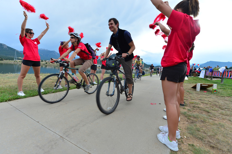 Cheerleaders give riders a fun send off for Friday evening's Community Bike Rode around Lake Estes. The event was a ride and festival to encourage locals to participate.