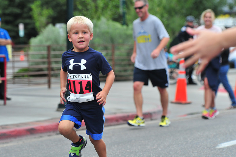 A young runner heads to the finish of the Elkhorn Sprint, a short, one-mile run on Saturday morning. The race was one of several events leading up to Saturday's Pro Challenge visit to Estes Park.