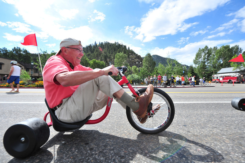 Mayor Bill Pinkham can't hold back, as he enjoys the big wheel races on Saturday Morning on Elkhorn Avenue. The festivities brought locals out to see America's Race.