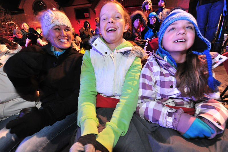 Parade fans, new and seasoned, were delighted to sit out in the mild evening to enjoy the annual Catch the Glow Parade on Friday. Between unseasonally warm temperatures and the reopening of the roads to Estes Park, the sidewalks were jammed well ahead of the start time for the Friday event.