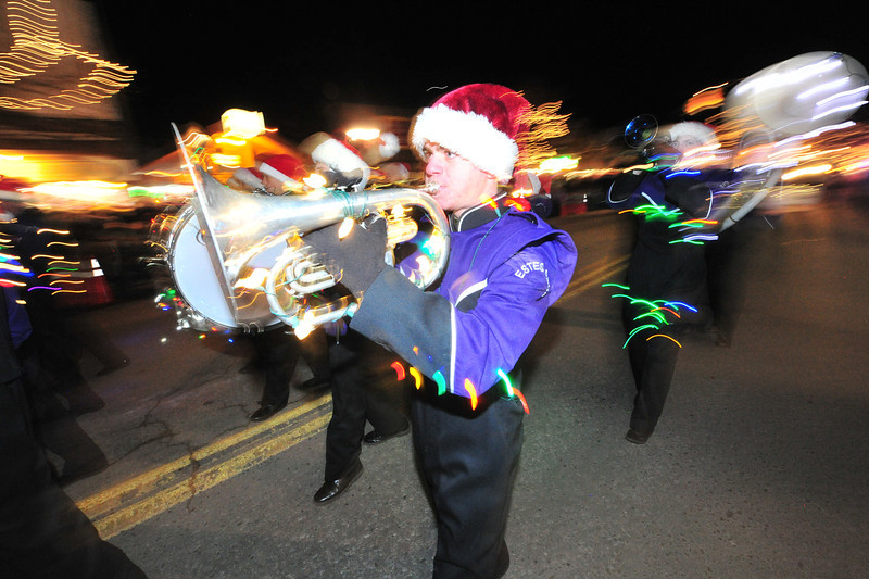 A crowd favorite, the Estes Park High School Marching Band wears their holiday lights down Elkhorn Avenue during Friday's Catch the Glow Parade. The parade featured plenty of symbols of the season and the community.