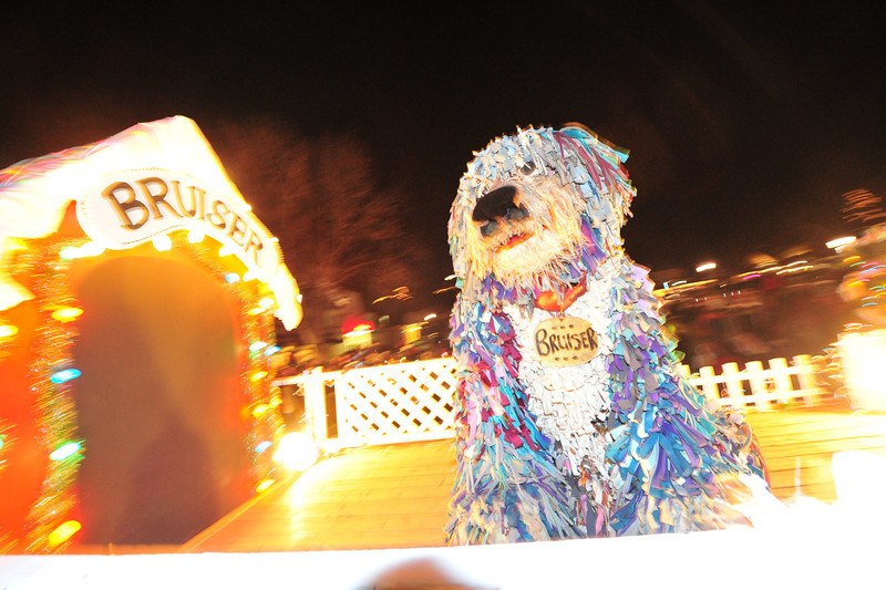 Bruiser barks in delight during the Catch the Glow Parade on Friday. Bruiser is a fixture of the holiday parade.