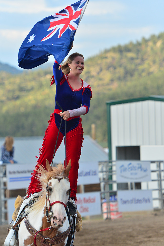 Sarah Thompson of New South Wales, Australia, flies her nations flag on Horseback on Tuesday night. Thompson is one of the Riata Ranch Cowboy Girls who perform all this week ahead of the Rooftop Rodeo.