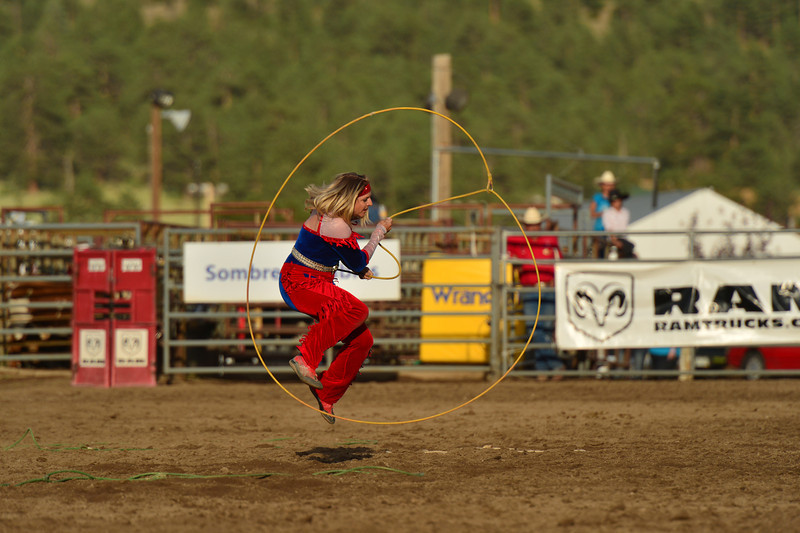 Jennisfer Welch Nicholson jumps through her rope during the Tuesday pre-show performance. She is the director of the Riata Ranch Cowboy Girls, as well as an accomplished trick roper.