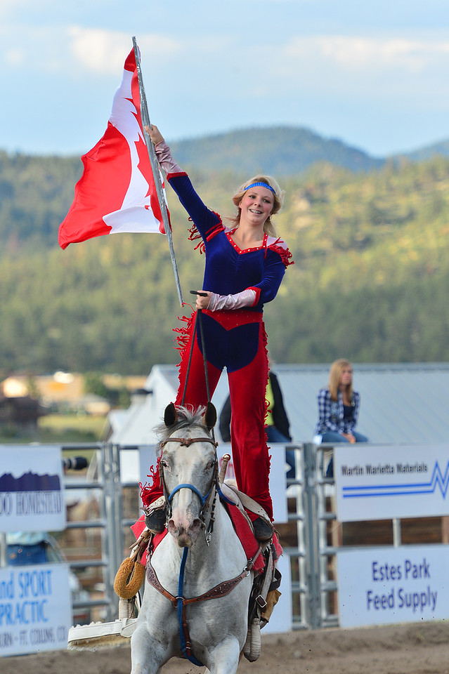 Emily Peebles of Sparwood, BC, Canada, smiles while displaying the Canadian maple leaf flag of Tuesday. Peebles representd our neighbors to the north in the Riata Ranch Cowboy Girls pre-rodeo show.