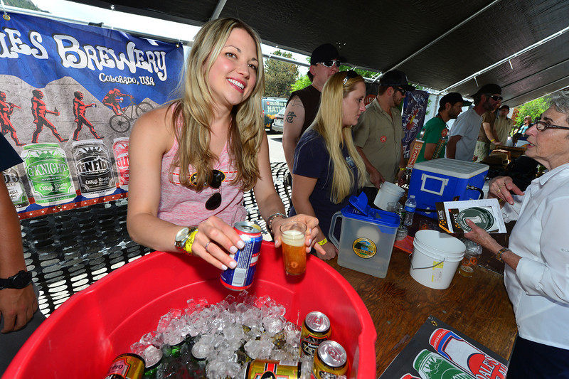 Sam Rutishauser of Oscar Blues Brewery hands out samples at the Rocky Mountain Brew Fest on Saturday. The Front Range, including Lyons and Estes Park, is considered Ground Zero for the craft brewing movement in the US.