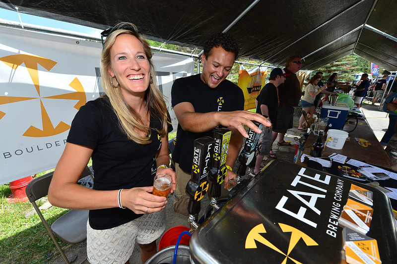 Erin and Mike Lawinski of Boulder's Fate Brewing Company pour samples on Saturday. Fate is one of the newest of the 140 breweries and brew pubs in a state that ranks fourth per capita for breweries in the US.