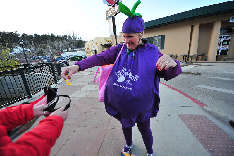 The Plumb Creek plumb hands out candy on Thursday. Estes Park businesses made sure to appear, reminding locals and visitors that Estes Park in open.