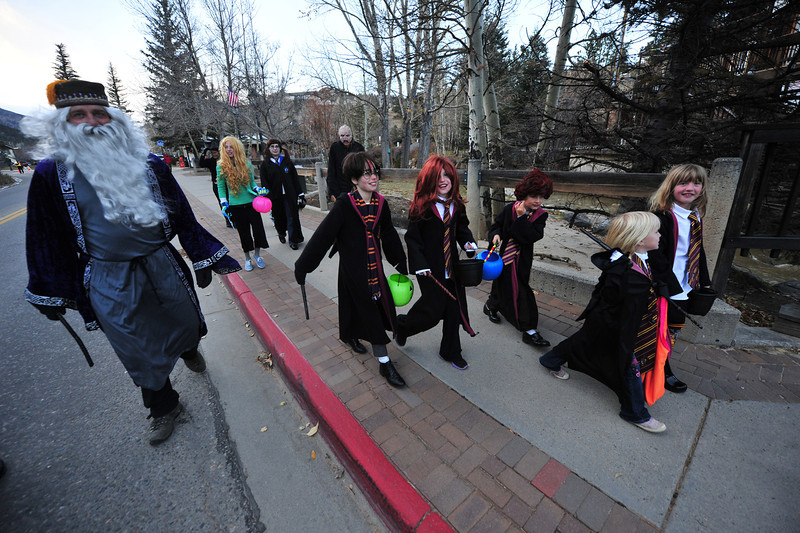Much of the cast of the Harry Potter movies prepares to collect goodies on Elkhorn Avenue on Thursday. Many families and friends got together for group costumes.