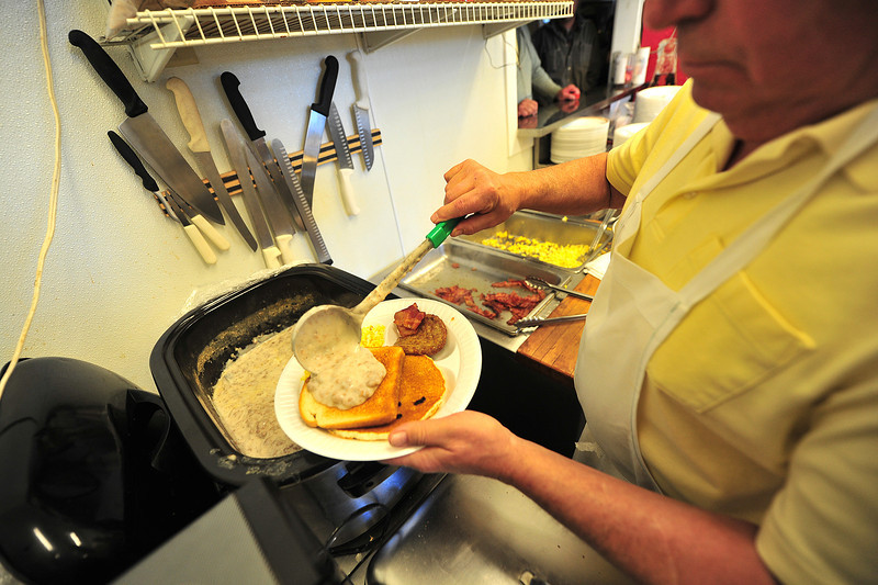 SOS, warm and lots of it, is served at the Veterans Day Breakfast at the American Legion on Monday. Creamed chipped beef of toast is almost as much a tradition among those who have served in the armed forces as Veterans Day itself.